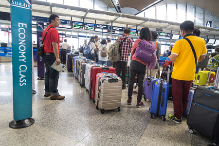 KUALA LUMPUR, MALAYSIA, November 3, 2018: Passenger with luggage queuing at check in counter at KLIA Airport