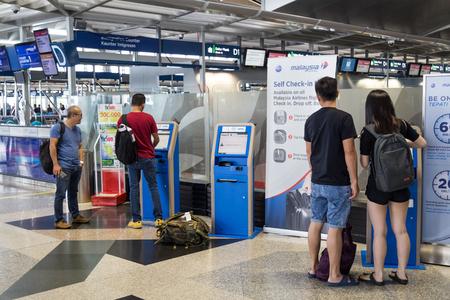 KUALA LUMPUR, MALAYSIA, November 3, 2018: Flight self service check-in kiosk machine at KLIA Airport Editorial