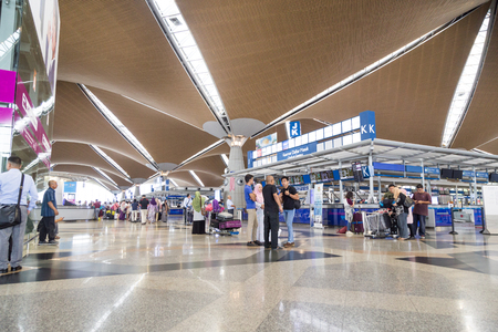 KUALA LUMPUR, MALAYSIA, November 3, 2018: Travelers walking around identifying their flights check-in counters at the main departure hall of KLIA Airport