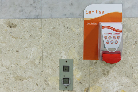 Public hand disinfectant sanitizer dispenser available in public amenity for hygiene purpose