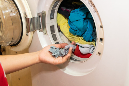 Handful of lint trapped in filter of laundry dryer clothes machine after drying Stock fotó