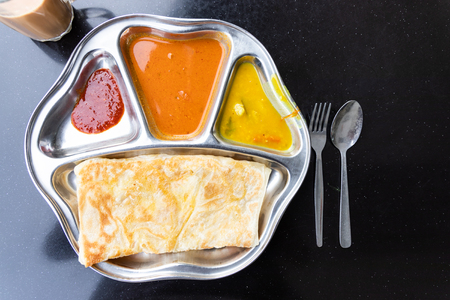 Roti prata or canai set with curry, dhal and sambal. Favorite breakfast in Malaysia 版權商用圖片