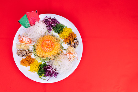 Serving of Yee Sang or Yusheng believed to bring luck. Taken during Chinese New Year by tossing with chopsticks