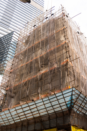 Bamboo scaffolding still widely used in construction in Hong Kong, instead of contemporary metal scaffoldings. Archivio Fotografico