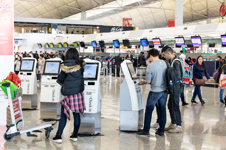 HONG KONG, February 9, 2019: Passengers doing flight self check-in at the automated check-in terminal