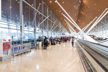 KUALA LUMPUR, FEBRUARY 9, 2019: Departure gates terminal at Kuala Lumpur International Airport KLIA are connected via the walkalator system.