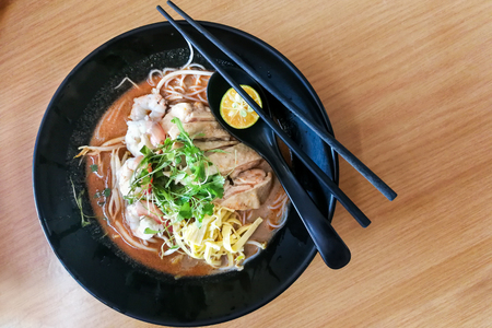 Sarawak laksa, popular food in Kuching. Vermicelli, spicy soup with shrimp and condiments