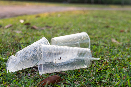 Indiscriminate dumping of PVC cups litter on public park pose danger to environment. Stock Photo