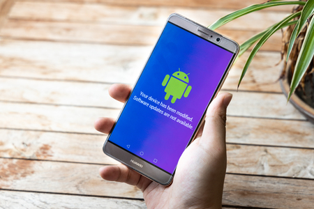 KUALA LUMPUR, MALAYSIA, MAY 25, 2019: Person holding Huawei Mate phone with Android message Software Updates Are Not Available. U.S. companies began  to curb sales to Chinese telecom Huawei