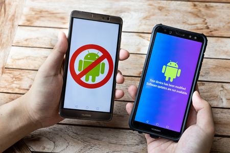 KUALA LUMPUR, MALAYSIA, MAY 25, 2019: Person holding Huawei phone with Android message Software Updates Are Not Available. U.S. companies began  to curb sales to Chinese telecom Huawei