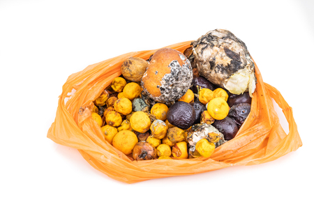 Bag contain rotten and moldy fruits and vegetable for compost production process Imagens