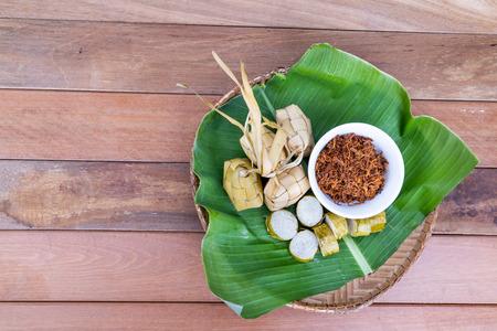 Ketupat, lemang, served with serunding, popular Malay delicacies during Hari Raya celebration in Malaysia