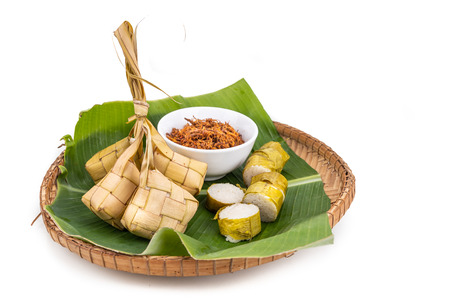 Ketupat, lemang, served with serunding, popular Malay delicacies during Hari Raya celebration in Malaysia 写真素材 - 124377109