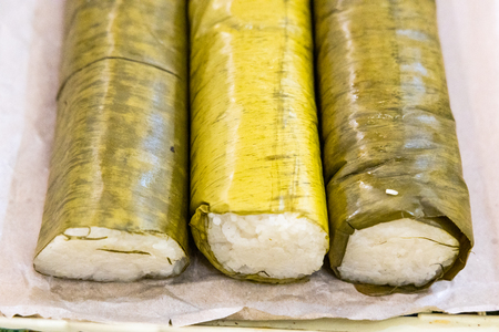 Thee rolls of lemang, glutinous rice cooked in bamboo, popular during Hari Raya celebration in Malaysia Stock Photo - 124377113