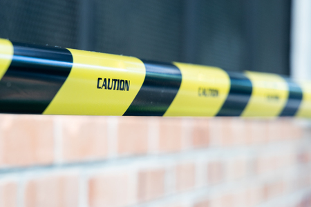 Closeup of Caution tape barricade area from access from premise location