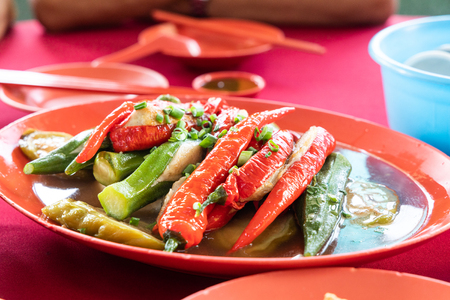 Yong Tau Fu, stuffed meat in vegetable is popular Hakka Chinese food in Malaysia. Available in fried or with soup. Banco de Imagens