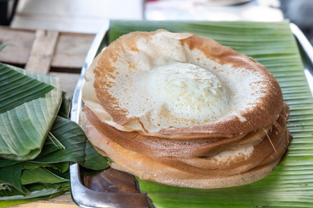 Penang famous apom manis, Simple and aromatic food served on banana leaf.