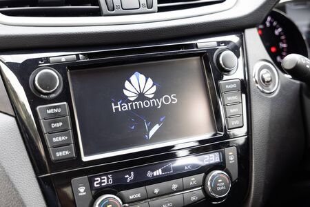 KUALA LUMPUR, MALAYSIA, August, 11, 2019: Huawei officially announced its new operating system, HarmonyOS. Illustrative visual of HarmonyOS on vehicle car honor smart screen