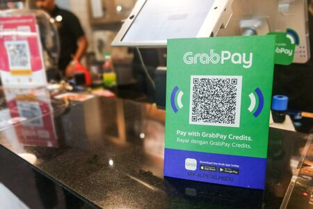 KUALA LUMPUR, MALAYSIA, September 17, 2019: Retail outlet restaurant displaying signage of Grabpay.  Online payment via Grabpay is accepted.