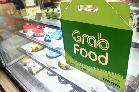 KUALA LUMPUR, MALAYSIA, September 17, 2019: Retail outlet restaurant displaying signage of Grabfood merchant. Grabfood is a fastest growing food delivery service in Asia.