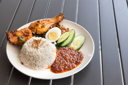 Nasi lemak with spice fried chicken, egg, anchovies, peanuts and sambal, Malaysia popular food