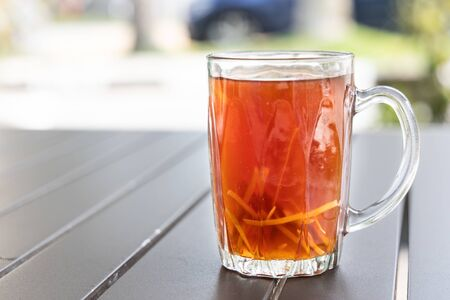Black tea with ginger slice or known as Teh O Halia in Malaysia