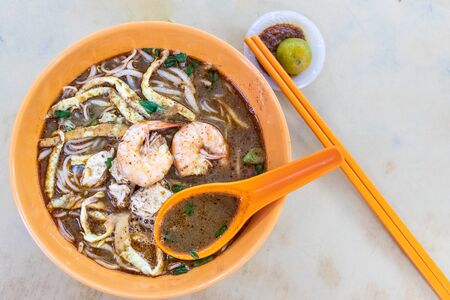 Simple serving of no frills Sarawak laksa with prawn and chicken meat