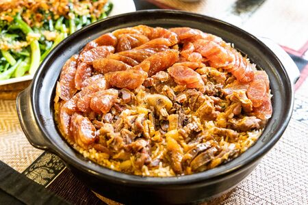 Claypot lap mei fan, or mixed wax meat rice, Chinese New Year delicacy among the ethnic Chinese.