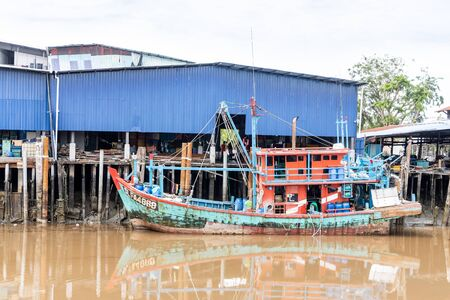 SEKINCHAN, MALAYSIA, February 16, 2020: Sekinchan is source of fresh seafood. Feature here is old fashion fisherman boat docked at jetty