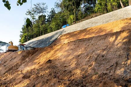 Slope retention construction work being carried out to manage landslide in highland Stockfoto