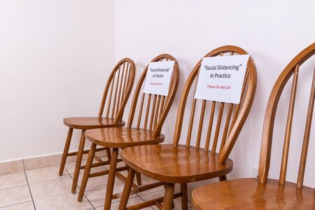Chairs with Social Distancing & Do Not Sit sign, to discourage close proximity between people to contain Covid-19 pandemic