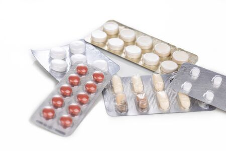 Strips of expired tablet, caplet  and capsule medicine on whte background Archivio Fotografico
