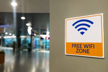 Free Wifi Zone word signage at public  place for patron's convenience Stock Photo