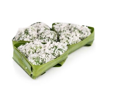 Ondeh ondeh is a traditional Malay snack made of rice ball filled with brown sugar, coated in grated coconut. Isolated in white