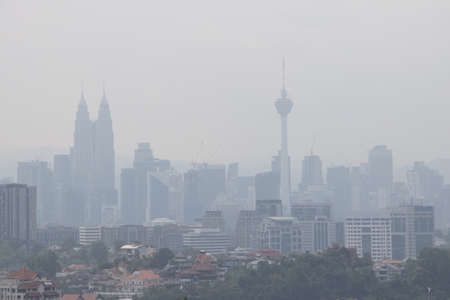 Hazy Kuala Lumpur city skyscape due to haze from forest fire in the region