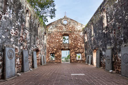 Portuguese hstoric ruins of Saint Paul Church with tombstone is Malacca popular tourist destination. No people.