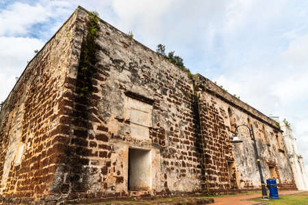 Portuguese historic ruins of Saint Paul Church with tombstone and statue is Malacca popular tourist destination. No people.