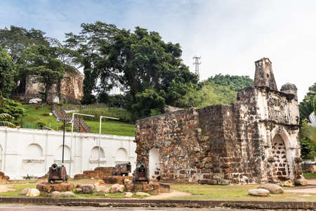 Historic ruins A Famosa is ancient Portuguese fortress with Saint Paul Church in background. Popular tourism destination in Malacca. No people.