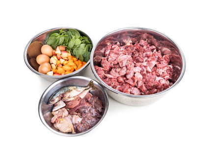 Ingredients of barf raw food recipe for dogs consisting meat, organs, fish, eggs and vegetable for good health