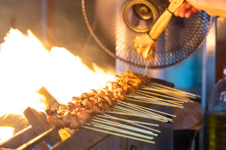 Close-up series of person barbequing satay with shallow depth of field, popular food in Malaysia and Indonesia 版權商用圖片