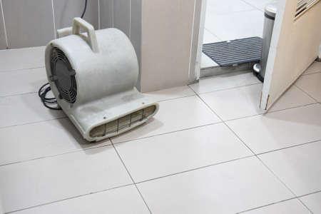 Floor dryer blower fan machine in bathroom drying wet floor