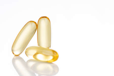 Close-up on fish oil capsule, contains omega-3 polyunsaturated acid EPA and DHA that enhances heart and health.