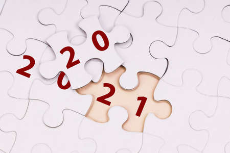 Concept of flipped puzzle piece transiting from 2020 to 2021 new year 版權商用圖片