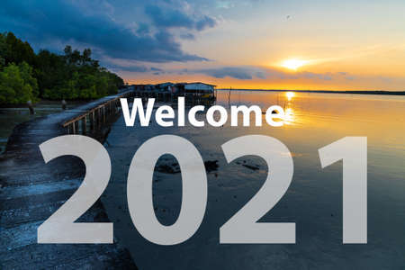 Welcome 2021 text against sunrise at scenic seaside in Malaysia