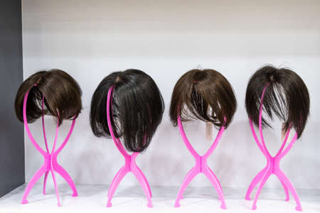 Wig with various hair length and style on display