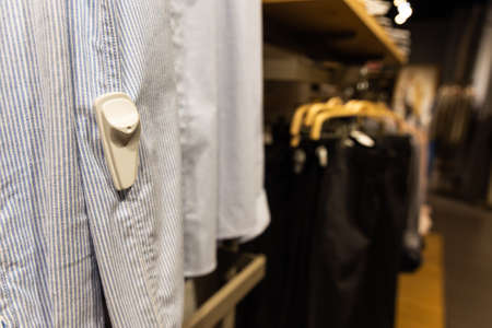 Close-up of RFID theft security tag attached onto apparels in clothing shop 写真素材