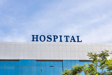 Close-up of building facade with Hospital word signage