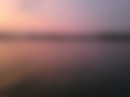 gloaming: sunset and river blurred background