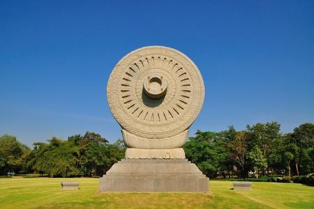 Carved stone Dhammajak at Buddhamonthon in Bangkok, Thailand Stock Photo - 8900600