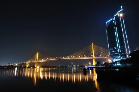 Rama 9 or Phraram 9 bridge over the Chaopraya river at night.